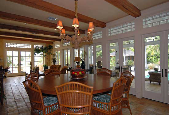A formal living and dining room flows to the sun room (pictured), family room, wine room, library and den.