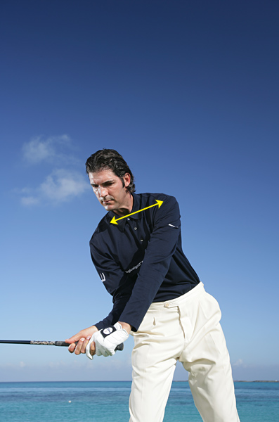 It's important to keep your head back and allow the left-shoulder move to re-create the distance between your left shoulder and your chin. This move produces huge amounts of force and the potential for extra distance with every club in your bag, More importantly, it eliminates swinging over the top and other errors that result in slices.