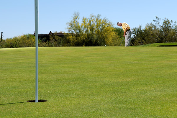How to Putt From a Top Tier                     It's only half a putt — the rest is gravity                     By Donald Crawley                     Top 100 Teachers                                          This story is for you if...                                          • You play a course with many multilevel greens.                                          • When you putt downhill, the ball always races past the hole and out of your makeable range.                                          The Situation                     Your approach shot carried too far and your ball is on the back tier of a green that slopes back to front.                                          The Solution                     This is a bit more complicated than an ordinary downhill putt. If you don't get the ball to the precipice, the ball will stay on the tier you're standing on, so you can't hit it soft like you do on a straight downhiller. Your goal is to roll the ball at the speed that allows it to just reach the cusp of the tier. The rest is gravity.