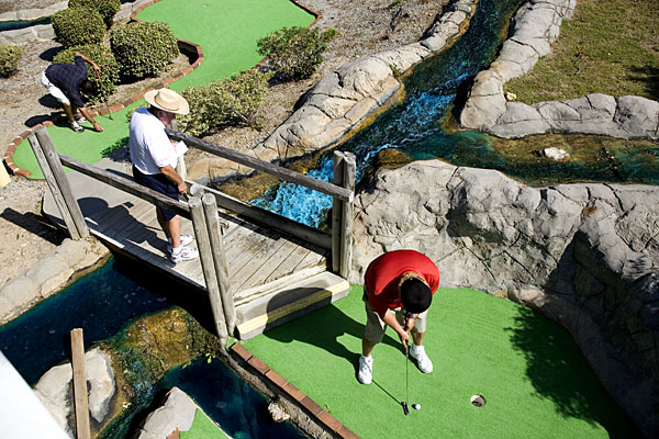 Mini Masters                     Each October the world's best professional miniature golfers convene in Myrtle Beach to                     compete for the game's most coveted title.                     That's right, professional miniature golfers.                                          Men at work: Don't tell these guys miniature golf is child's play.