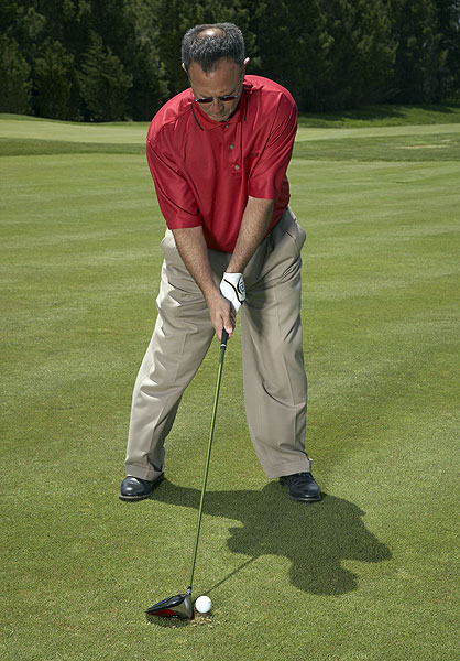 STEP 2                                          To promote the low, piercing ballflight you need, play the ball slightly back of where you normally tee your driver. Choke down for extra control.                                                               STEP 3                                          Make your regular driver swing, but since the ball sits below the level of your normal tee height, focus on keeping the club low through impact. You should feel like you're hitting an elongated punch shot, with your arms extending fully from their sockets through impact.