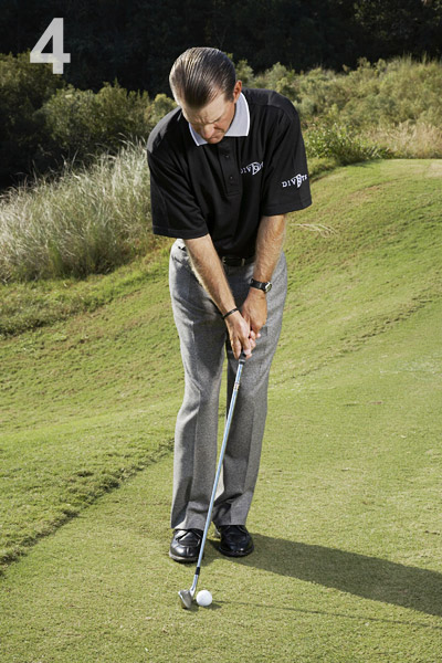 STEP 4                       Drop your putter and stand close to the ball with your feet together and your weight left.