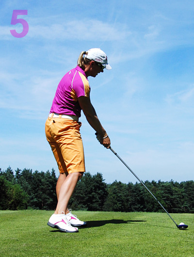 Classic: Hips more open than her shoulders, weight on her left heel and clubshaft leaning toward the target. Neo-classic: The release of her eyes and chin (much like Robert Allenby and Darren Clarke, among others).