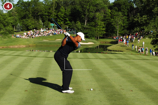 Tiger has maintained the tilt from his waist that he set at address, which allows his shaft to remain on plane (check out how the butt end of the club points at the target line). This is a perfect recipe for consistent ballstriking.