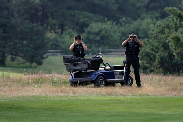 While some of Obama's men followed their leader in golf carts, others (the United States Secret Service counter assault team, for example) watched from the fescue.