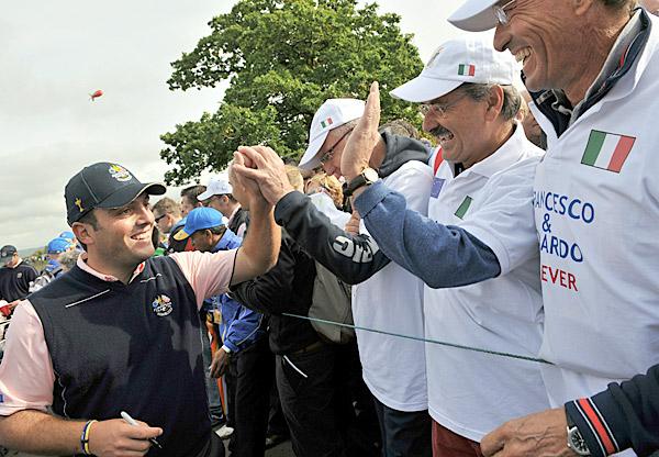 Edoardo Molinari greets some admirers.