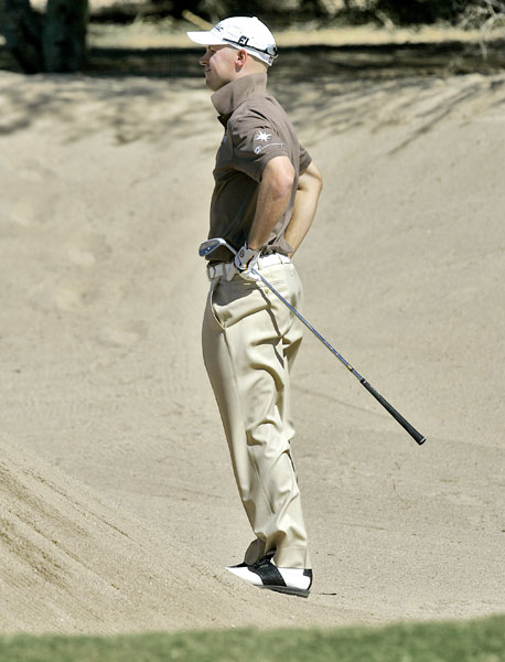 Ben Crane had to jump to see his bunker shot on No. 2. Crane shot a one-under 69.