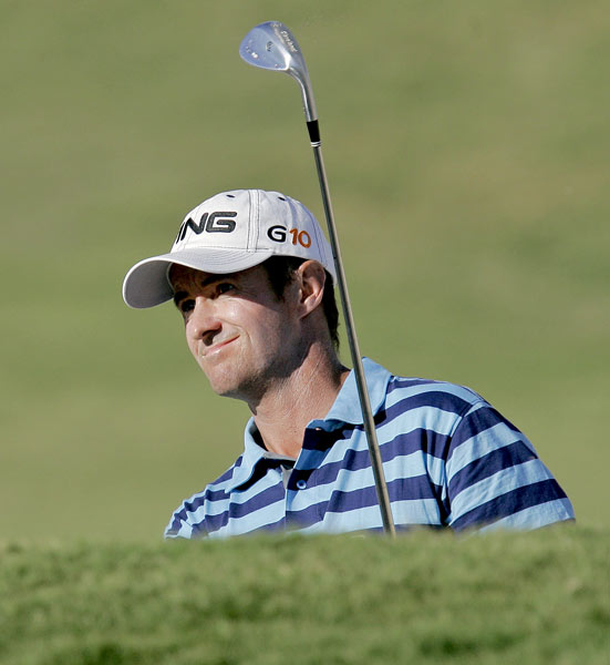Mark Hensby bogeyed 18 to fall out of a tie for the lead.