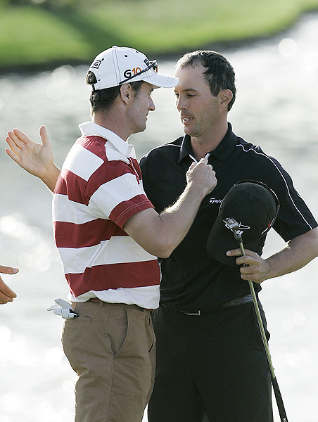Mark Hensby, left, finished one stroke behind Weir at 13 under par.
