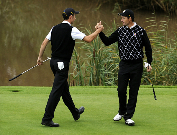 handed Phil Mickelson and Dustin Johnson a 3-and-2 thumping.