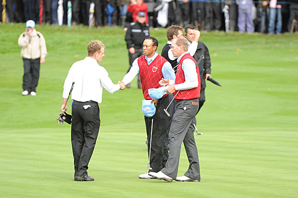 Donald (left) and Westwood quickly won the match, disposing of Woods and Stricker 6 and 5.