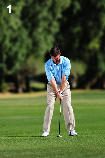 HOW TO BLAST FROM A DIVOT                                              1. Position the ball two ball-widths back from your left heel.