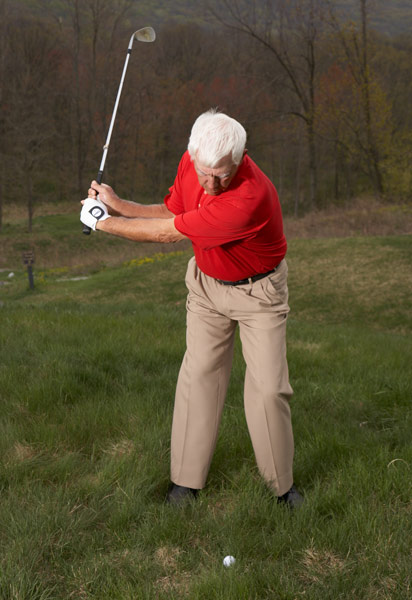 STEP 2                                              Take the club back easy so that your hands are at least waist-high when the shaft points straight up.