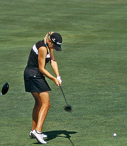 "As she approaches impact, you can see that she has still managed to retain the leverage created by the 90-degree angle formed by her left arm and the clubshaft. It's not until her hands are almost past her right thigh that the ""L"" begins to unhinge and the stored energy whips the clubhead into the ball. This is a perfect example of how a good player keeps his or her hands ahead of the clubhead until the very last moment before impact — and it's exactly the move you need for maximum power."