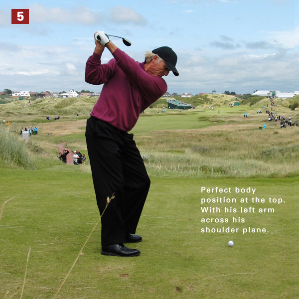 5. Although his club moves across the line (it's pointing right of his target), he establishes two top-position musts: Shoulders turned 90 degrees and left arm matching the shoulders.