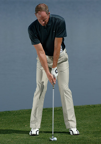 3 From here, simply form your normal grip. You're now set up for perfect impact.
