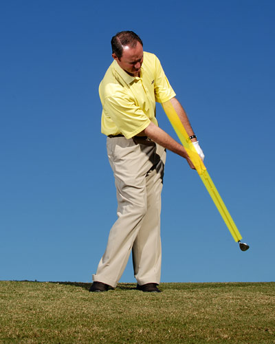 "How to Stop Flubbing Chips                      Make a 'y' in your finish to hit crisp chips                                           By Chuck Winstead                     Top 100 Teacher                                          This story is for you if...                                          • You never make crisp contact when you chip...                                          • ...and you catch these shots fat more often than you'll admit.                                          Check This!                     When you take your normal chipping stance with your feet close together and the ball played just back of center, notice how your shaft leans toward the target, forming a lower-case ""y"" with your forearms.                                          How to Strike Crisp Chips                                          Make sure the ""y"" exists in your address position, but don't think about keeping it intact at impact. Your goal is to make your impact position as smooth and natural as possible, without having to think about it. Instead, make sure the ""y"" is intact when you swing the club back (i.e., don't lose the hinge in your wrists in your takeaway) and that it's still there when you finish your swing (i.e., don't lose the hinge going forward). If you can manage to make a ""y"" between your forearms and clubshaft before and after impact, you'll guarantee that it will be there when you strike the ball. If you have difficulty, try chipping with ""dead arms,"" and moving your wedge back and through more with your body turn."