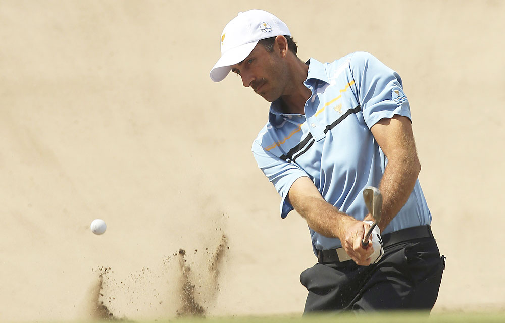 Geoff Ogilvy and Charl Schwartzel led for most of their match against Bill Haas and Nick Watney, but the U.S. team rallied late to halve the match.