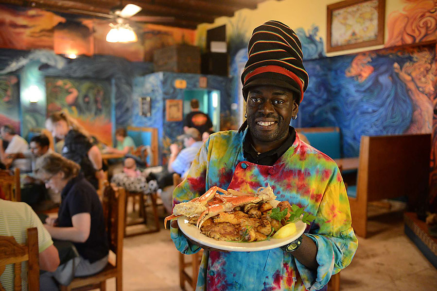 Chef David grew up on the island and owns and operates the Roast Fish and Cornbread Restaurant, which specializes in fresh local seafood, organic hamburgers and a vegetarian selection. Chef David is holding his classic Port Royal seafood platter.