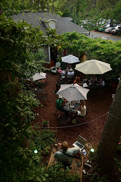 The atmosphere at the Backyard Restaurant is like your favorite friend's summer backyard party, with live music, small tables, and a fire pit.