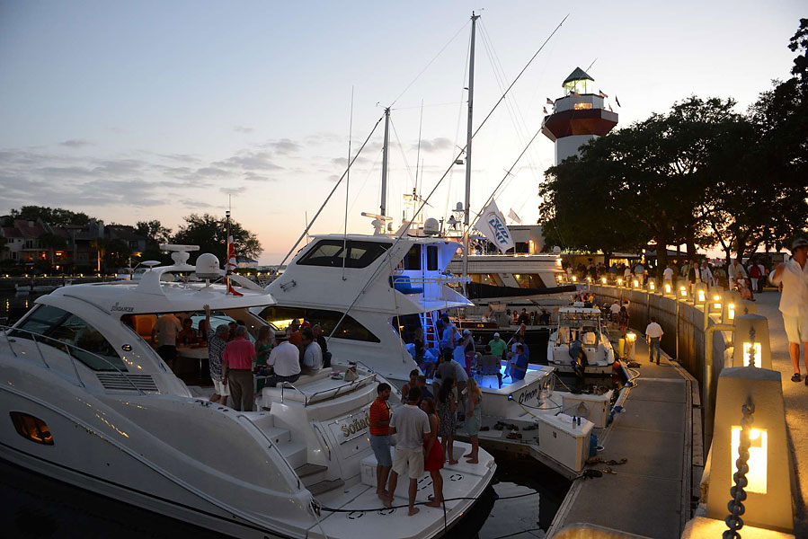 People flock to their boats in the marina at Harbour Island to celebrate.