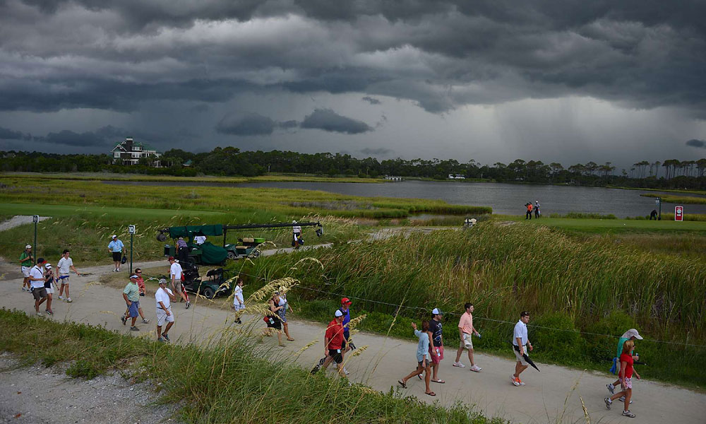 Storms rolled into the Ocean Course on Saturday, producing some of the most dramatic images of the week. The third round was halted and resumed on Sunday morning.
