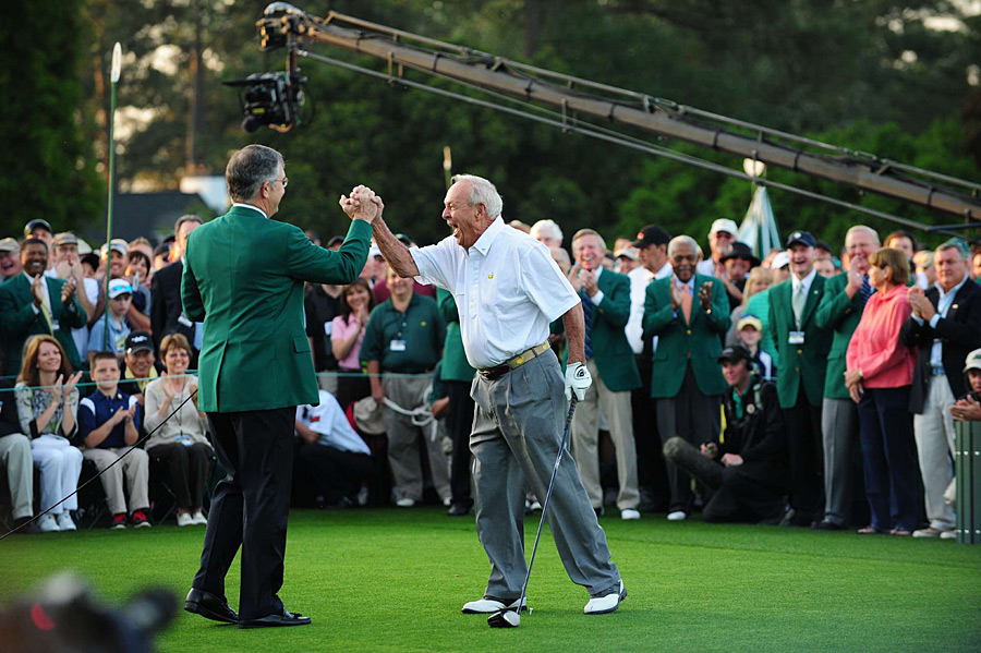 Palmer gave Augusta National Chairman Billy Payne a high-five after striping his tee shot down the fairway.