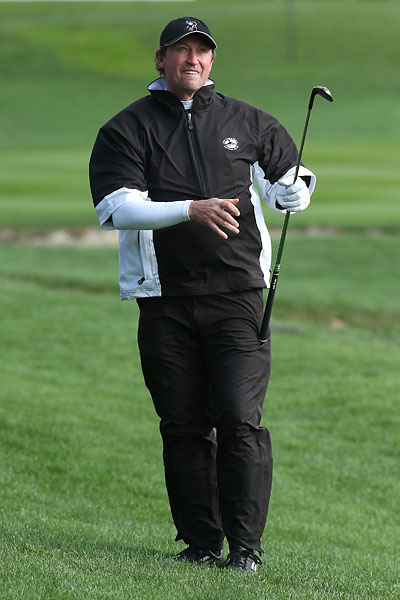 Former professional hockey player Wayne Gretzky watches his approach shot on the third hole during the third round of the AT&T Pebble Beach National Pro-Am at the Pebble Beach Golf Links on Saturday.