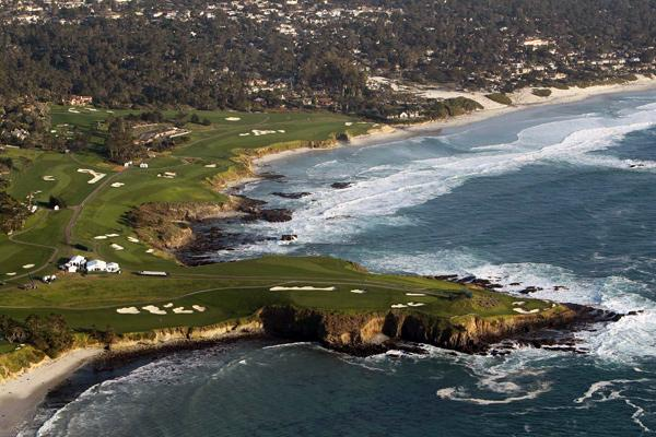 Pebble Beach                     In the foreground of this photo is the 6th hole, a 523-yard par-5. The 6th green leads directly to the tee of the par-3 7th, and then on to the toughest stretch on the course — holes 8-10. After the 10th, seen here in the background of the photo along the water, players get a break with holes 11-14 (back left), which are a safe distance from the cliffs.