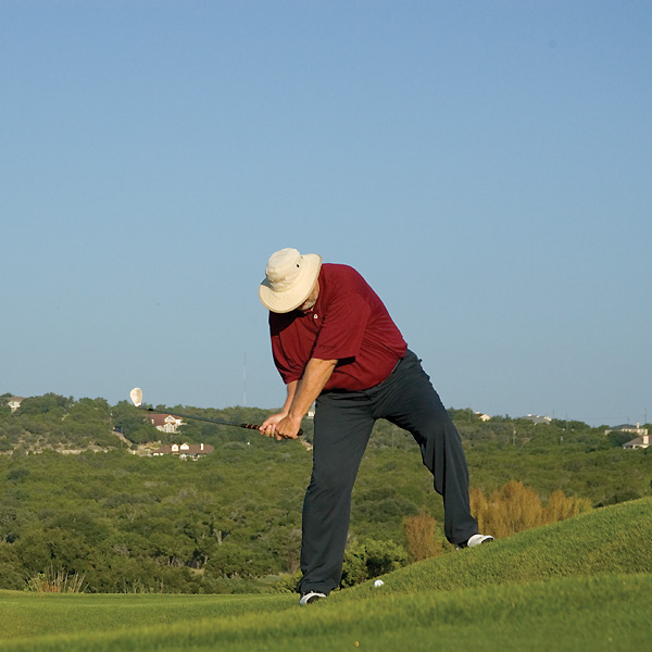 Why'd I do that?                                              Golfers tend to stand straight up when addressing a shot on an upslope, but this is wrong. A vertical posture points your body lines and downswing club path into the slope,                       which causes you to slow your club down before it bangs into the ground at impact, leaving your shot short.