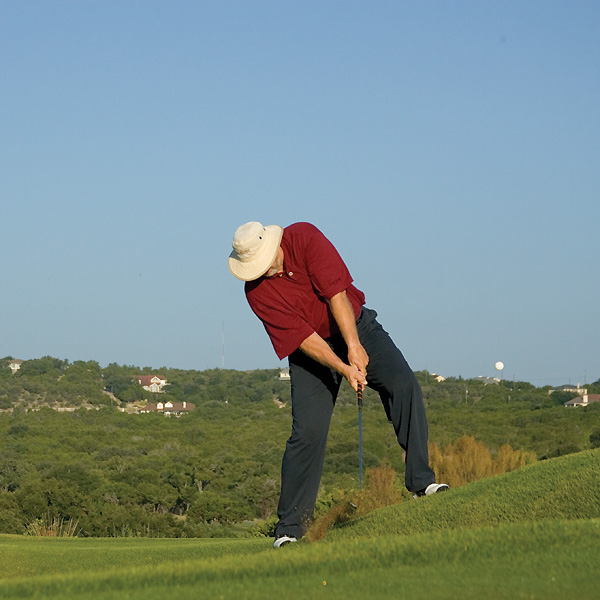 "How to not do that                                              The next time you need to play a wedge from an uphill lie, try the ""fall-back"" shot. Select a less lofted wedge than you'd normally use from the same distance on a level lie to compensate for the height the slope will add to the shot."