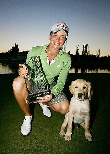 Suzann Pettersen posed with the Blackhawk Country Club dog, Bogey, after winning the 2007 LPGA Longs Drugs Challenge.