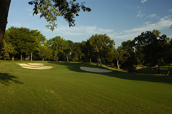 No. 5                    653 Yards, Par 5                   This dogleg left is the longest hole at Southern Hills. To avoid the fairway bunkers and keep the ball in the short grass, many players will not even think of going for the green in two. Laying up to the ideal distance will be extremely important as the green has two large bunkers guarding the front and a hump in the front-middle section that can make putting extremely challenging.