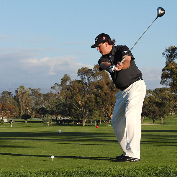 Mickelson has set the club in a lighter, more vertical position. This helps him gain control over the club. In the past, he set the club much later with a wide extended arch, which allowed for more power, but less control.