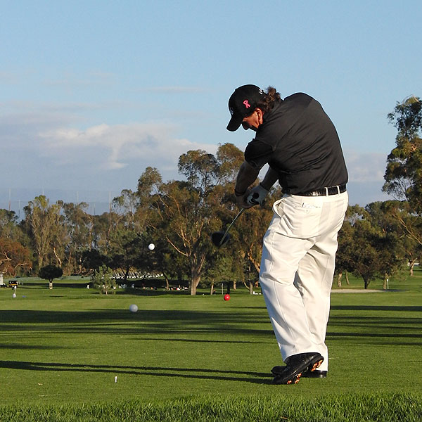 Mickelson continues to rotate through the shot, as the arms and body swing through to a balanced finish.