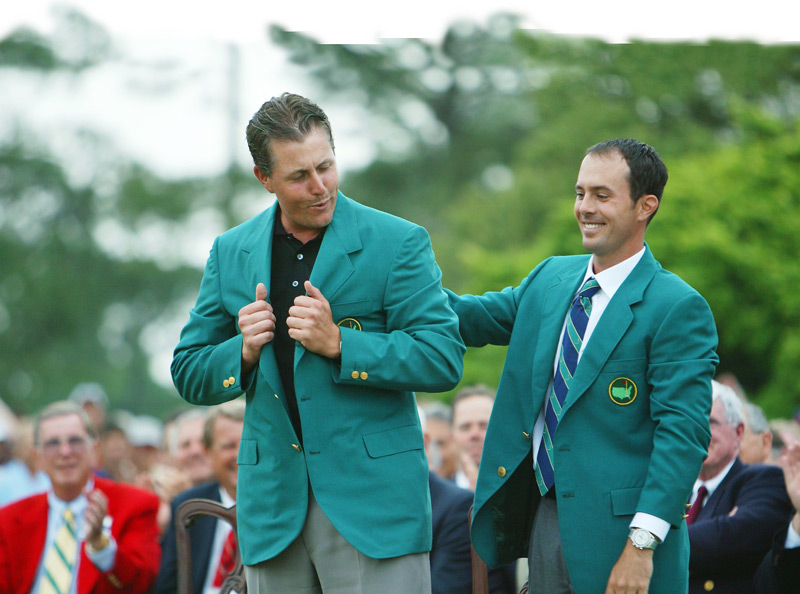 Mickelson received the green jacket from fellow lefty Mike Weir.