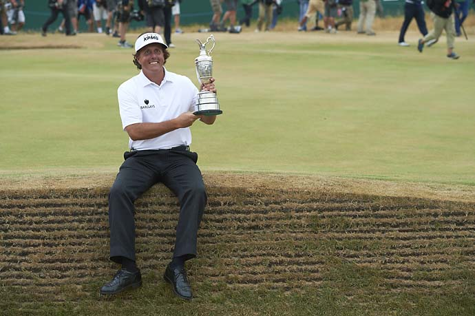 Phil Mickelson victorious, holding Claret Jug trophy after winning tournament on Sunday at Muirfield in July 2013.