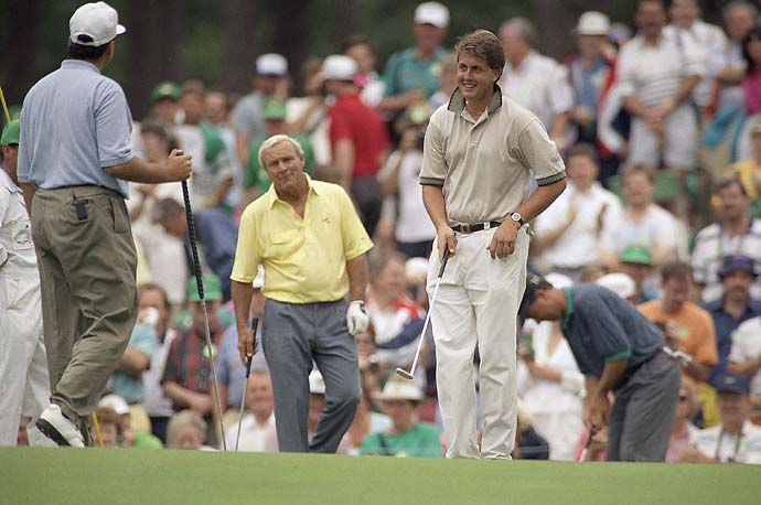 U.S. Amateur Champion Phil Mickelson practices with Arnold Palmer and Rocco Mediate during practice for the 1991 Masters at the Augusta National Golf Club in Augusta, Georgia on Tuesday, April 10, 1991.