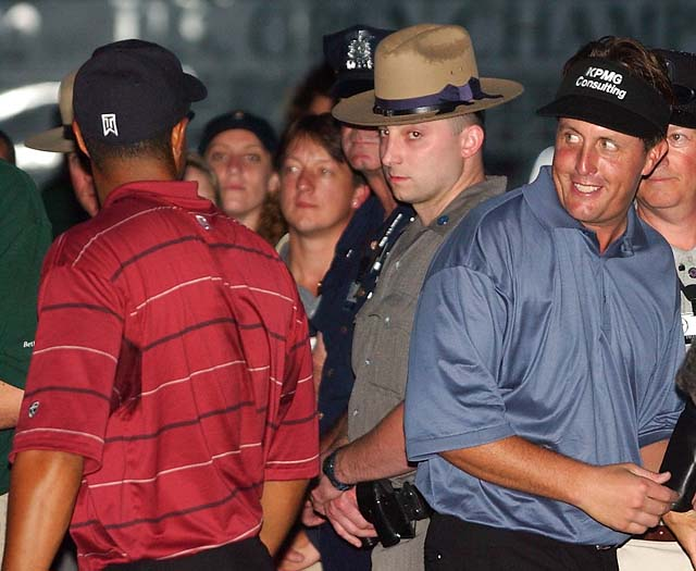 Phil Mickelson smiles at Tiger Woods after Woods won the 2002 U.S. Open Golf Championship at the Black Course of Bethpage State Park in Farmingdale, N.Y., Sunday, June 16, 2002. Woods finished three strokes ahead of Mickelson.