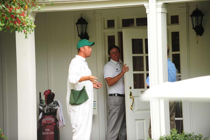 Phil Mickelson and caddie Bones Mackay after a practice round at the 2009 Masters.