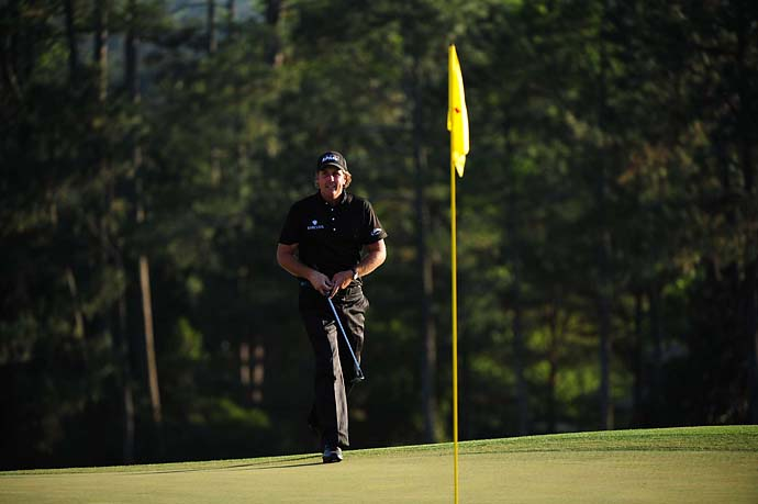 Mickelson stalks Augusta National on the final day of the 2010 Masters, his third green-jacket win.
