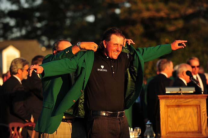 Angel Cabrera puts the green jacket on Phil Mickelson after Mickelson's third Masters win at the 2010 Masters.