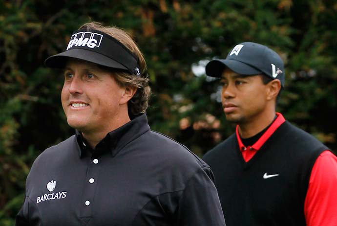Phil Mickelson and Tiger Woods are seen on the second tee during the final round of the AT&T Pebble Beach National Pro-Am at Pebble Beach Golf Links on February 12, 2012 in Pebble Beach, California. Mickelson got the best of his rival that day, beating Woods by 11 shots and winning the tournament.