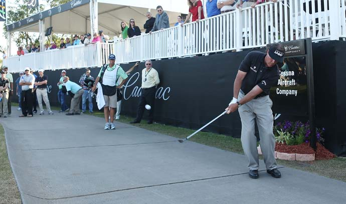 Phil Mickelson plays off the cart path on the 17th green during the first round of the 2007 WGC-Cadillac Championship at the Trump Doral Golf Resort & Spa in Miami, Florida.
