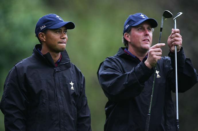 Tiger Woods compares wedges with teammate Phil Mickelson on the 3rd hole during the second official practice day of the 2006 Ryder Cup at The K Club on September 20, 2006 in Straffan, Co. Kildare, Ireland.