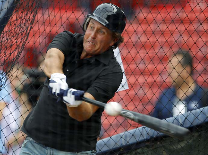 Phil Mickelson takes batting practice before the MLB American League baseball game between the New York Yankees and the Boston Red Sox at Fenway Park in Boston, Mass., September 1, 2011.