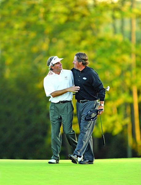 Fred Couples congratulates Phil Mickelson on the 18th hole of the 2006 Masters, Mickelson's second Masters victory.