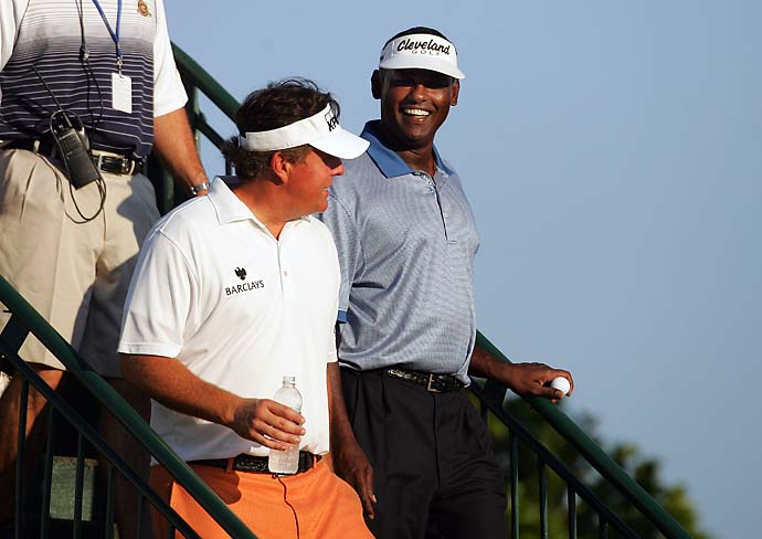 Phil Mickelson and Vijay Singh share a laugh before the first round of the 2011 PGA Championship golf tournament at the Atlanta Athletic Club. After a round at the 2005 Masters, Singh confronted Phil Mickelson in the locker room and argued that Phil's metal spikes had roughed up the greens. They reportedly had to be separated by onlookers.