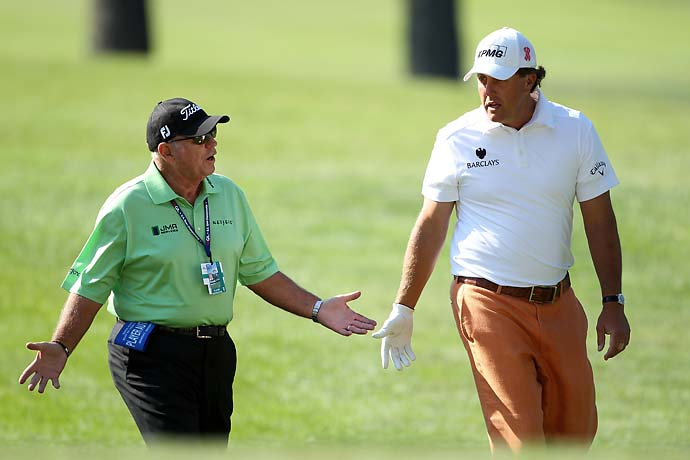 Phil Mickelson chats with his coach Butch Harmon during a practice round prior to the start of the 111th U.S. Open at Congressional Country Club on June 14, 2011 in Bethesda, Md. Harmon supposedly shared Tiger Woods' secrets with Mickelson when he started coaching Mickelson.