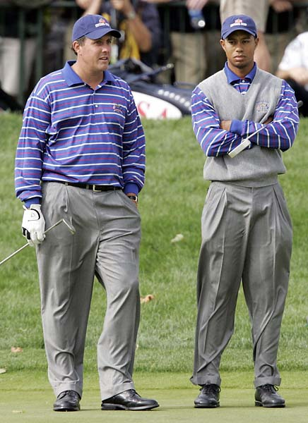 Tiger Woods and Phil Mickelson and with each other on the ninth hole during their four-ball match at the 2004 Ryder Cup at Oakland Hills Country Club in Bloomfield Township, Mich. Mickelson and Woods went 0-2 in team play and have never been paired together again.